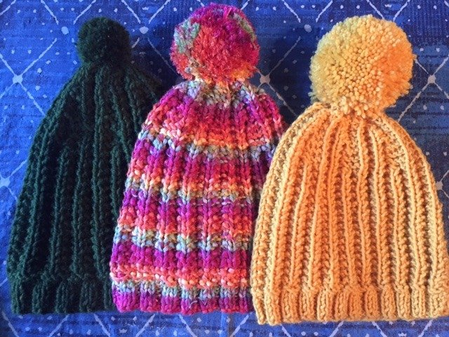 The 1967 Ribbed Beanie in three different colors. Great for a man, woman, or older child! Free pattern-- My Workbasket