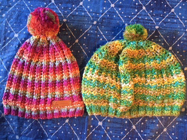 The Ribbed 1967 Beanie on the left, and the 1967 Beret on the right, both available as a free knitting pattern-- My Workbasket