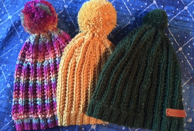 Three different colors of the 1967 Beanie. A free hat knitting pattern! -- My Workbasket