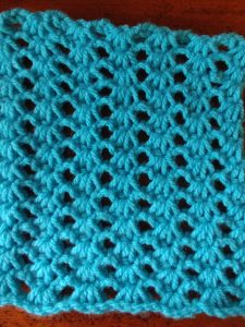 A square of Tunisian Lace Stitch, with a step by step video tutorial to make your own. -- My Workbasket