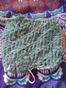 One side of my Knook Slipper Sock in Progress- My Workbasket