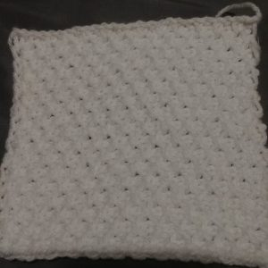 A completed square of the Tunisian Crochet Honeycomb stitch with step by step video tutorial. -- My Workbasket