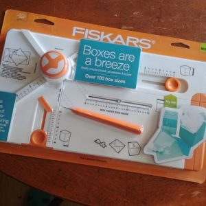 The Fiskars Boxmaker- a handy tool that makes custom sized boxes and envelopes as well as cute paper bows! My Workbasket