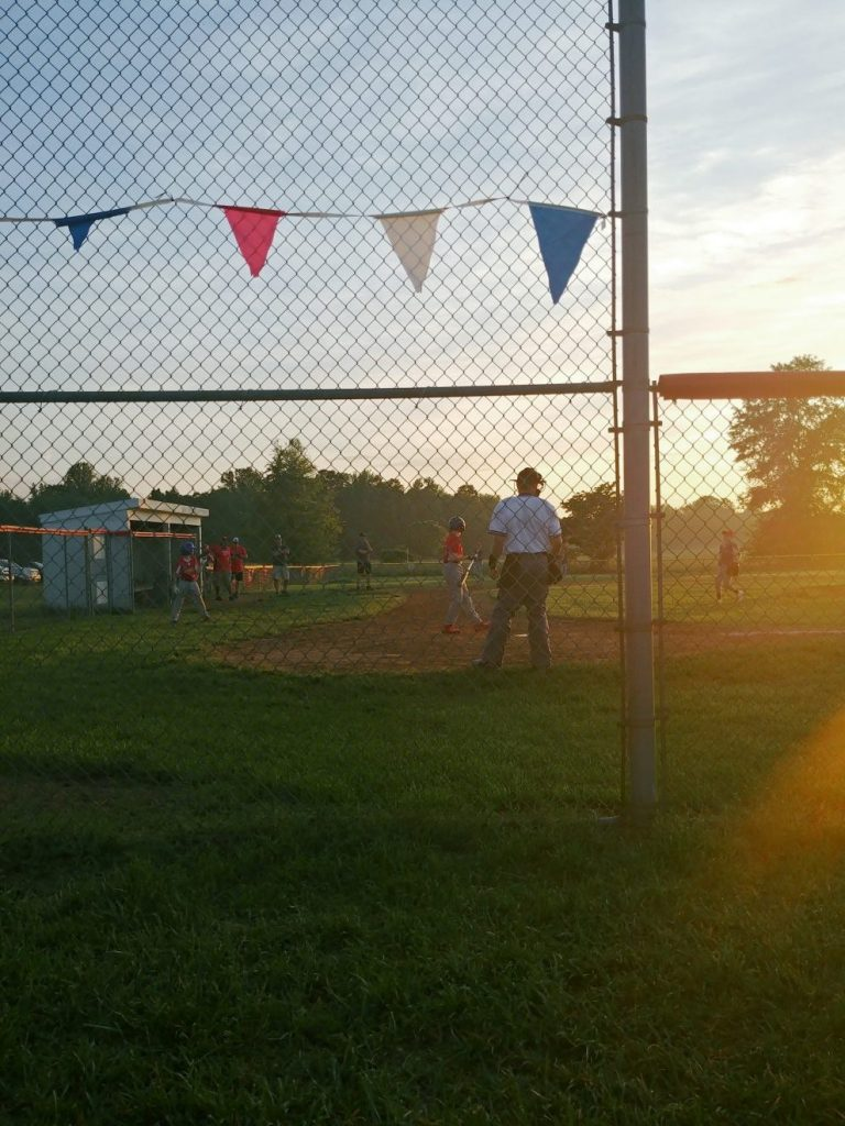 Baseball as the sun goes down.